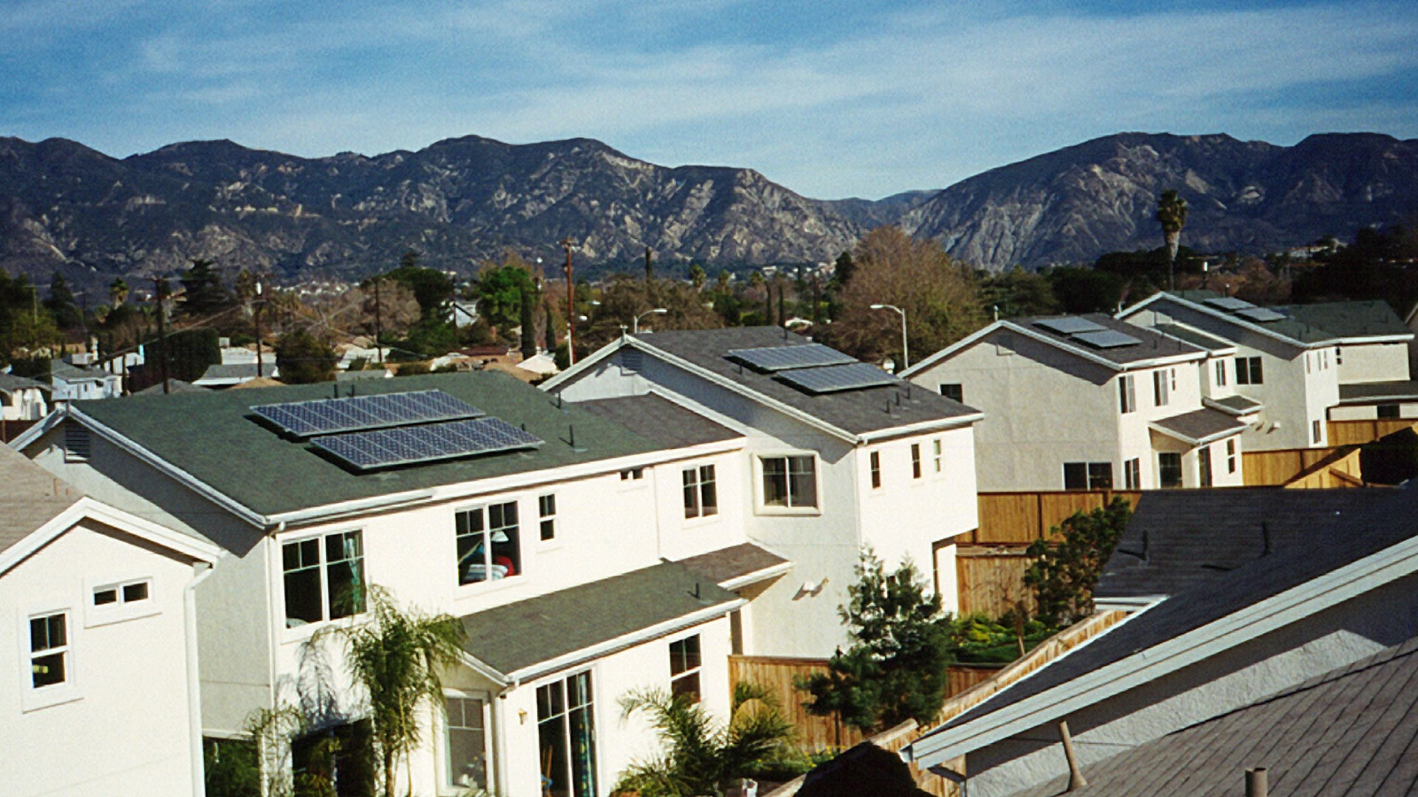 """<h4>Shining Cities</h4> <h5>America's major cities have played a key role in the clean energy revolution and stand to reap tremendous benefits from solar energy.<br><br><a href=""""https://environmentamericacenter.org/reports/ame/shining-cities-2017"""" target=""""_blank"""">Learn more...</a></h5> <em>Village Green, California / National Renewable Energy Laboratory Photo</em>"""